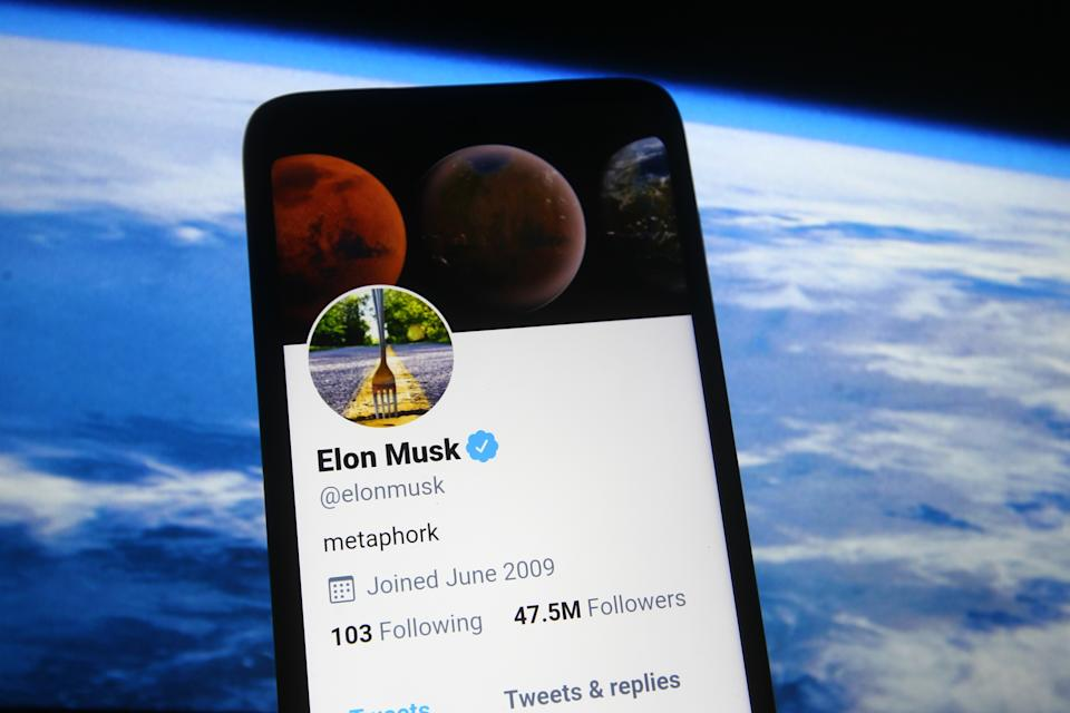 UKRAINE - 2021/02/21: In this photo illustration a Twitter webpage of Elon Musk is seen on a smartphone screen in front of Spacex website. (Photo Illustration by Pavlo Gonchar/SOPA Images/LightRocket via Getty Images)