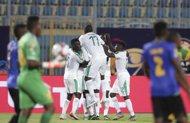 Senegal's players celebrate after they scored second goal during the African Cup of Nations group C soccer match between Senegal and Tanzania at 30 June Stadium in Cairo, Egypt, Sunday, June 23, 2019. (AP Photo/Hassan Ammar)