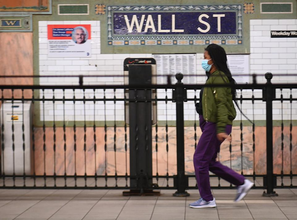 A person walks at the Wall Street subway stop on April 23, 2020 in New York City. - More than one in five New Yorkers may have already had the new coronavirus, a testing sample showed April 23, 2020, suggesting infections are much higher than confirmed cases suggest. Widespread testing -- including for antibodies -- is viewed as key to American states being able to lift stay-at-home orders and reopen their shuttered economies. (Photo by Angela Weiss / AFP) (Photo by ANGELA WEISS/AFP via Getty Images)