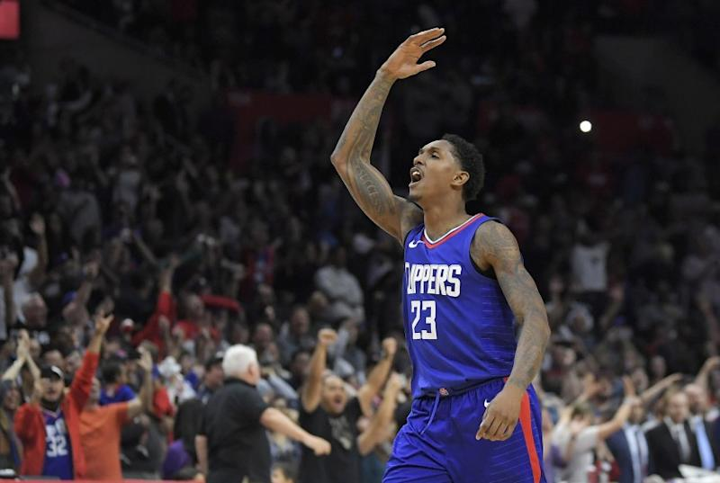 Los Angeles Clippers guard Lou Williams celebrates after scoring late in the second half of an NBA basketball game against the Washington Wizards, Saturday, Dec. 9, 2017, in Los Angeles. The Clippers won 113-112. (AP Photo/Mark J. Terrill)