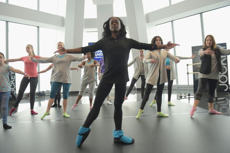 Ballerina Michaela DePrince -- who was abandoned by her uncle during the civil war in Sierra Leone and was later adopted by an American family -- pictured teaching a class in New York City