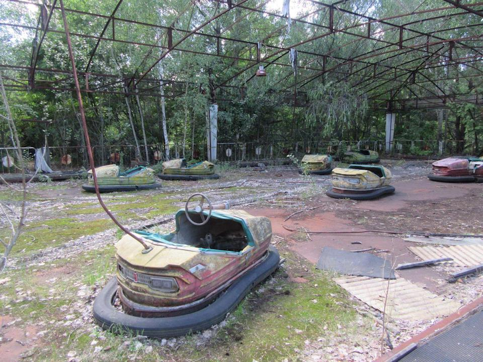 "<p>Structures of all variations sit empty in the abandoned city of Chernobyl. Including this bumper car pavilion, which serves as a ghostly reminder that civilians had to abruptly pack their belongings and leave. </p><p>Photo: Flickr/<a href=""https://www.flickr.com/photos/amanderson/35660537981/in/photolist-WwShN2-WkczxK-WkcFYv-ZLAKb5-21naWvN-28LXGf9-GSjmFn-NQE5oY-28LXERh-NDQgPS-GncPZy-G8UFSA-6w5i3e-NKD8em-Gbcu8g-NVZbrM-6p7Cwm-FfWkZD-FfKpDL-G33QQG-PmHop-GbcuX2-MXRAop-FfWkCB-dMhehM-GbcrG4-MXRn7K-6N8Q1F-FfWiJr-22mw3eP-G32ZNo-6t9zoD-FL64oY-FfWiBH-ikXTA8-G8Uuy3-G5m6JT-G8UDtC-G33aWu-8oXQ25-6NcZ2N-ikXmf3-dMhekM-ikX8K4-WwSgNB-NVZfMk-Epq2wN-4a45Ve-DU9XJe-Zya2GH/"" rel=""nofollow noopener"" target=""_blank"" data-ylk=""slk:amanderson2"" class=""link rapid-noclick-resp"">amanderson2</a></p>"