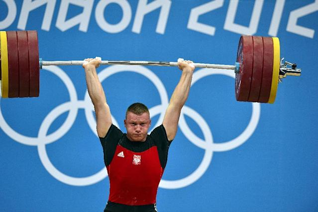 Poland's Tomasz Bernard Zielinski competes during the men's 94kg group B weightlifting event of the London 2012 Olympic Games at The Excel Centre in London on August 4, 2012 (AFP Photo/YURI CORTEZ)