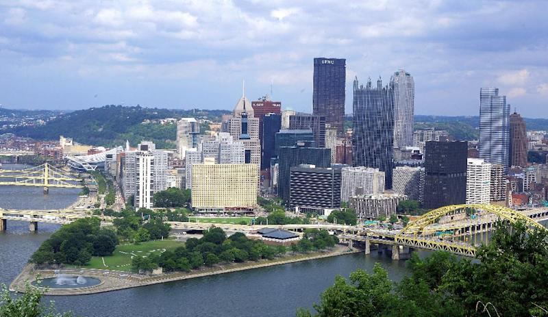 In this Aug. 18, 2009, aerial photo is downtown Pittsburgh located at the confluence of the Allegheny, Monongahela and Ohio rivers on the north side of Pittsburgh. Like Detroit, Pittsburgh was a community defined by its dependence on a single industry. But as steelmaking crumbled under pressure from foreign imports and the decline of the U.S. auto industry, the city's population dropped by more than 40 percent between 1970 and 2006, according to a 2013 report from the U.S. Federal Reserve Bank of Cleveland. But during those years, Pittsburgh also forged a new identity around health care and technology. Detroit's bankruptcy can't be blamed solely on the city's reliance on one industry that itself buckled. Some point to the city's political leadership and its reluctance over the years to make tough decisions. (AP Photo/Gene J. Puskar)