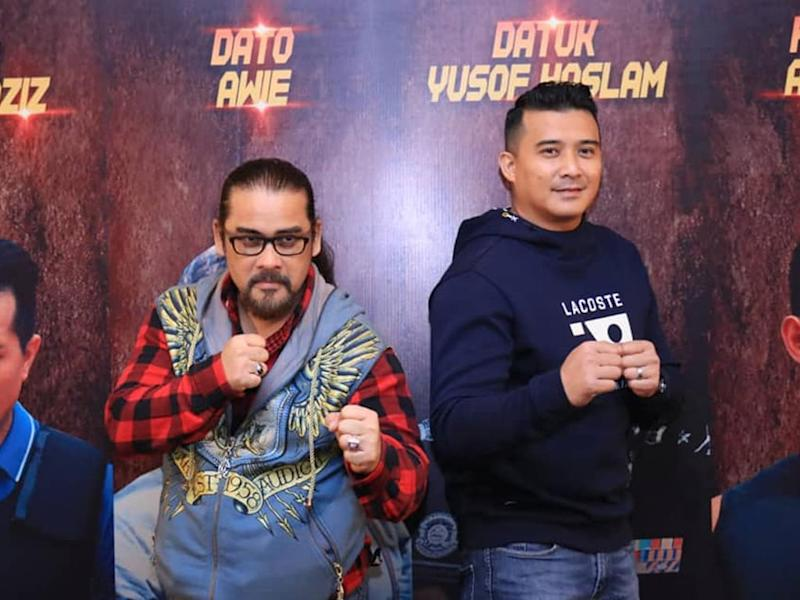 "Datuk Awie and Aaron Aziz at the premiere of ""Operasi X""."