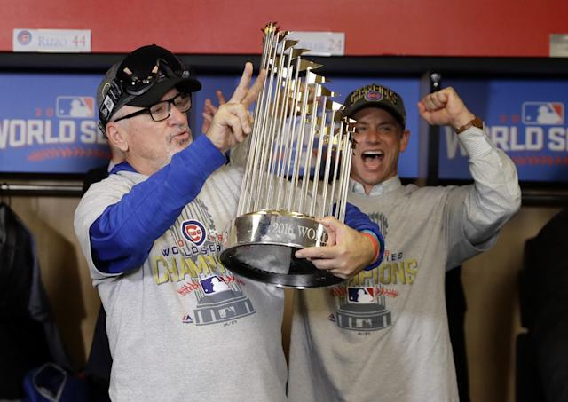 <p>Chicago Cubs manager Joe Maddon (70) holds the commissioner's trophy after game seven of the 2016 World Series against the Cleveland Indians at Progressive Field. Mandatory Credit: David J. Phillip/Pool Photo via USA TODAY Sports </p>