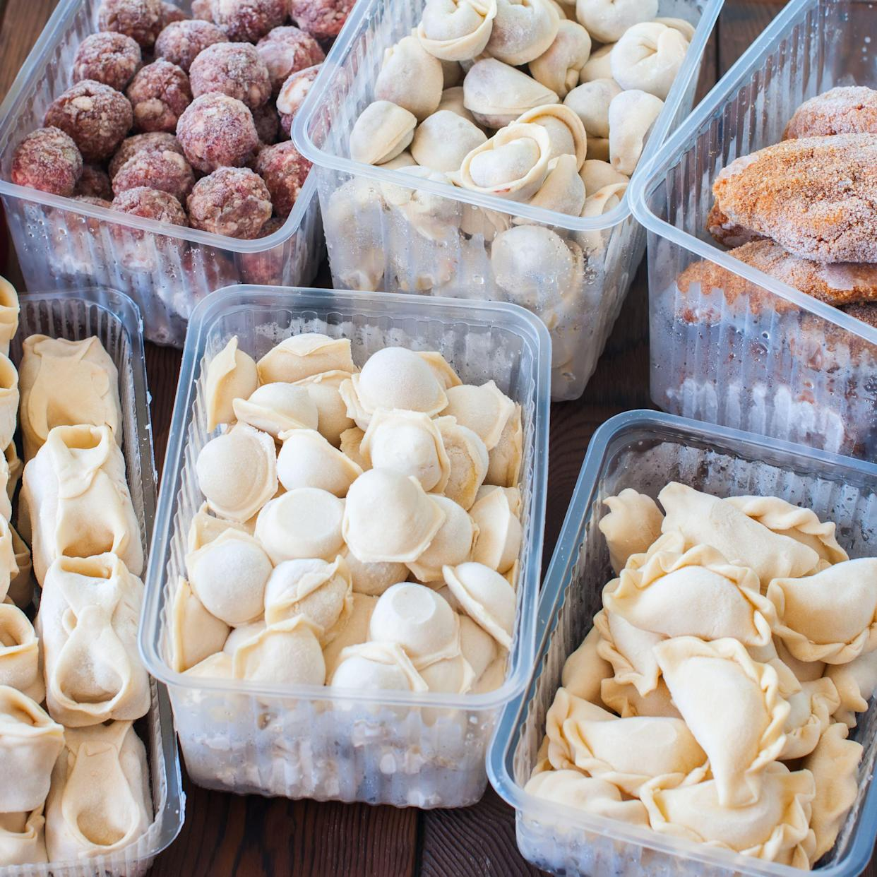 Assortment of Pocket items. Semifinished meatballs, dumplings, pierogi in plastic containers.