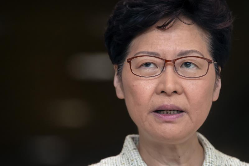 "Hong Kong Chief Executive Carrie Lam speaks during a press conference at the government building in Hong Kong, Tuesday, Oct. 15, 2019. A homemade, remote-controlled bomb intended to ""kill or to harm"" riot control officers was detonated as they deployed against renewed violence in Hong Kong over the weekend, police said Monday, in a further escalation of destructive street battles gripping the business hub. (AP Photo/Mark Schiefelbein)"