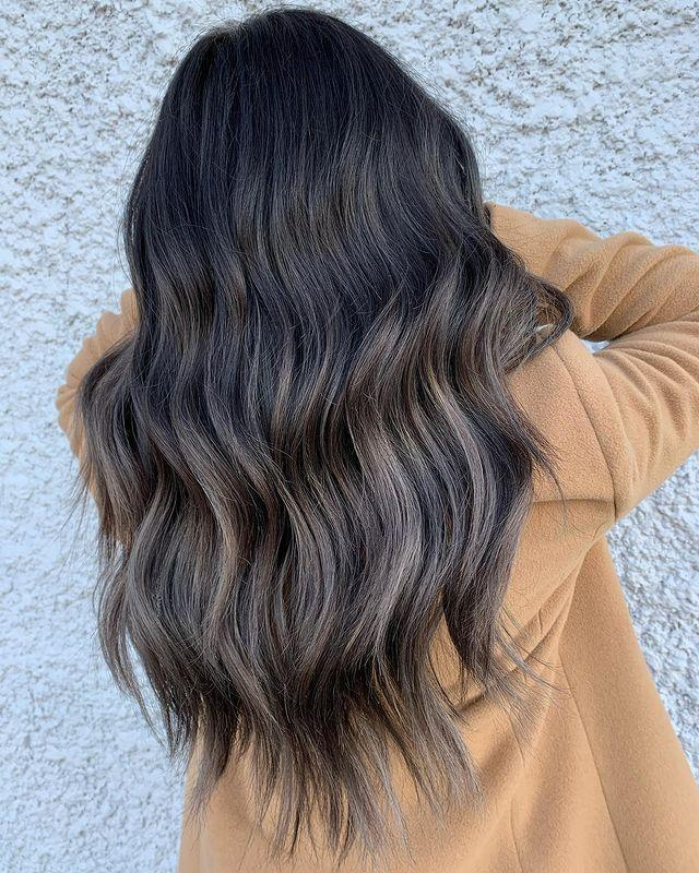 """<p><a href=""""https://www.cosmopolitan.com/style-beauty/beauty/g31993074/blonde-balayage-hairstyles/"""" rel=""""nofollow noopener"""" target=""""_blank"""" data-ylk=""""slk:Balayage"""" class=""""link rapid-noclick-resp"""">Balayage</a>—i.e. hand-painted highlights—is great way to get in on the ash-brown hair color trend if you're looking for something a bit more subtle. The roots remain nice and dark, but <strong>the lengths have some ashy—but blended!—highlight</strong><strong>s for contrast.</strong></p><p><a href=""""https://www.instagram.com/p/CGtVHlYAnj4/"""" rel=""""nofollow noopener"""" target=""""_blank"""" data-ylk=""""slk:See the original post on Instagram"""" class=""""link rapid-noclick-resp"""">See the original post on Instagram</a></p>"""