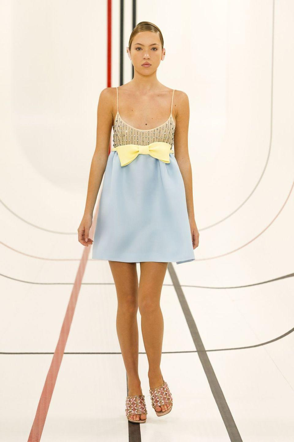 <p>Moss wore three looks at the sports-themed show, but wore the same jewelled mules throughout.</p>