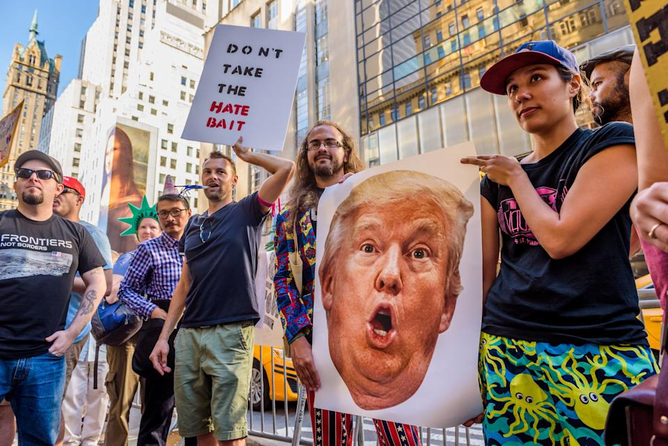 People protest Donald J. Trump's 71st birthday, in New York City on June 14, 2017. Hundreds of people gathered outside Trump Tower for a #SadBirthday party, celebrating the ongoing resistance to his presidency.(Photo by Erik McGregor) *** Please Use Credit from Credit Field ***