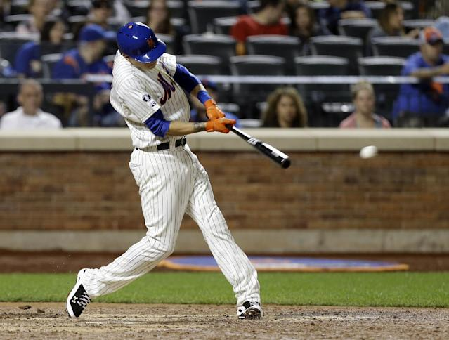New York Mets' Wilmer Flores hits a two-run double during the seventh inning of a baseball game against the San Francisco Giants Saturday, Aug. 2, 2014, in New York. (AP Photo/Frank Franklin II)