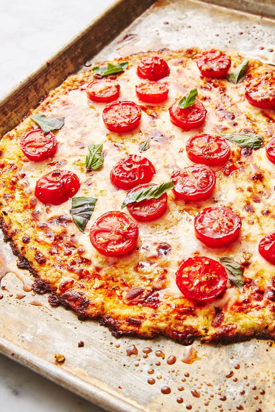 "<p>You have a pizza my heart. </p><p>Get the recipe from <a href=""https://www.delish.com/cooking/recipe-ideas/recipes/a47565/cauliflower-crust-pizza-recipe/"" rel=""nofollow noopener"" target=""_blank"" data-ylk=""slk:Delish"" class=""link rapid-noclick-resp"">Delish</a>. </p>"