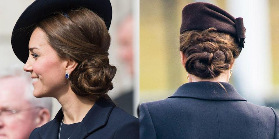 <p>A hat is no excuse for a boring hairstyle; The Duchess of Cambridge styles hers with a coiled side-bun in 2015.</p>