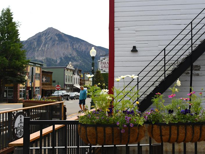 a mountain behind the small town of crested butte