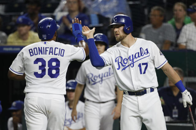 Kansas City Royals' Jorge Bonifacio (38) is congratulated by Hunter Dozier (17) after scoring on a Ryan O'Hearn single during the fourth inning of a baseball game against the Toronto Blue Jays at Kauffman Stadium in Kansas City, Mo., Thursday, Aug. 16, 2018. (AP Photo/Colin E. Braley)