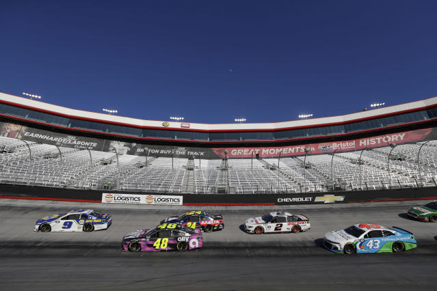 Cars speed around the track as empty stands are seen in the background during a NASCAR Cup Series auto race at Bristol Motor Speedway Sunday, May 31, 2020, in Bristol, Tenn. The race is being run without fans in the stands due to the coronavirus outbreak. (AP Photo/Mark Humphrey)