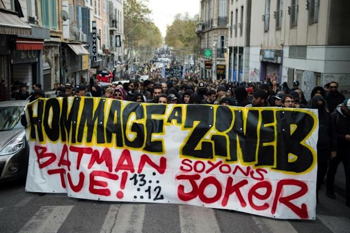 """Protestors hold a banner reading """"Tribute to Zineb. Batman kills, let's be the Joker"""" during a march in tribute to Zineb Redouane who died at the age of 80 in December 2018 after being hit by a police tear gas grenade (AFP Photo/CLEMENT MAHOUDEAU)"""