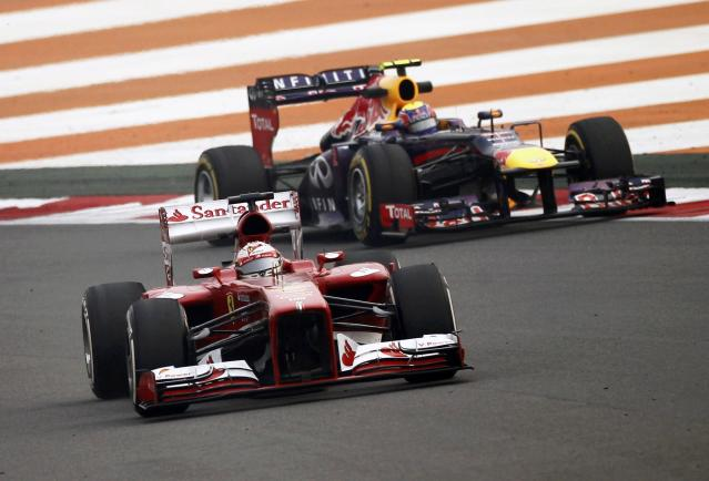 Ferrari Formula One driver Fernando Alonso of Spain (front) drives ahead of Red Bull Formula One driver Mark Webber of Australia during the second practice session of the Indian F1 Grand Prix at the Buddh International Circuit in Greater Noida, on the outskirts of New Delhi, October 25, 2013. REUTERS/Anindito Mukherjee (INDIA - Tags: SPORT MOTORSPORT F1)