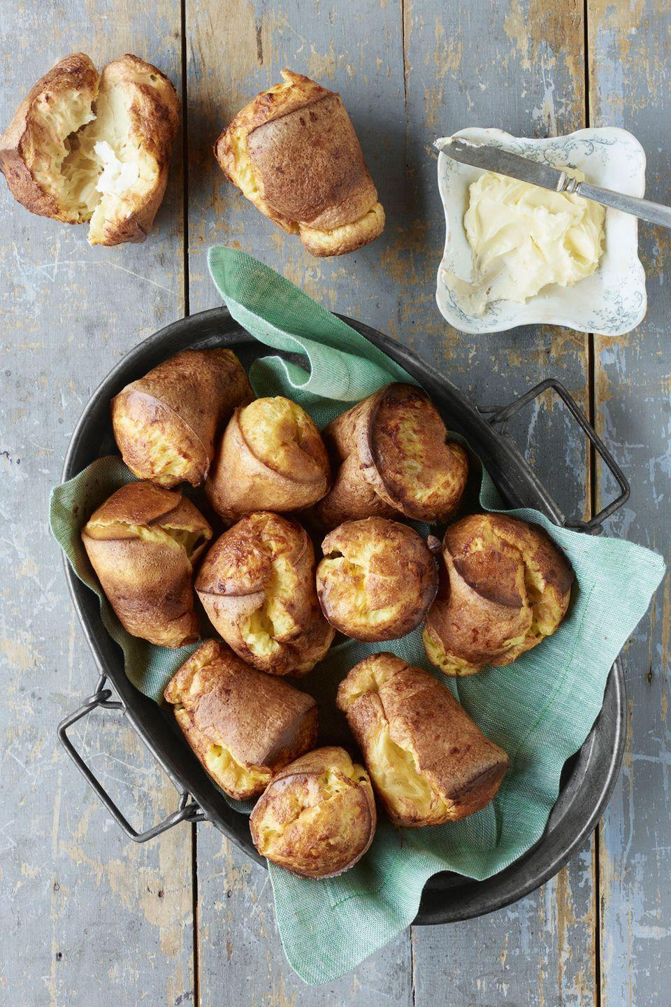 "<p>Trade in traditional bread rolls for Cheddar popovers. </p><p><strong><a href=""https://www.countryliving.com/food-drinks/recipes/a4149/cheddar-popovers-recipe-clv0413/"" rel=""nofollow noopener"" target=""_blank"" data-ylk=""slk:Get the recipe"" class=""link rapid-noclick-resp"">Get the recipe</a>.</strong></p>"