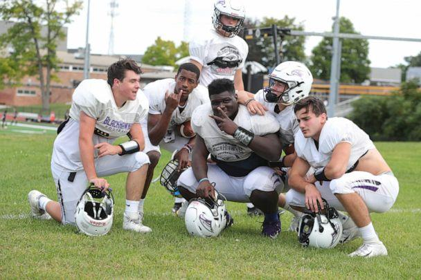 PHOTO: Bloomfield Hills defensive lineman Devin Holmes, center, who is deaf, strikes a pose with teammates during practice on Wednesday, Sept. 4, 2019, at Bloomfield Hills High School. (Kirthmon F. Dozier/Detroit Free Press via Imagn Content Services, LLC)