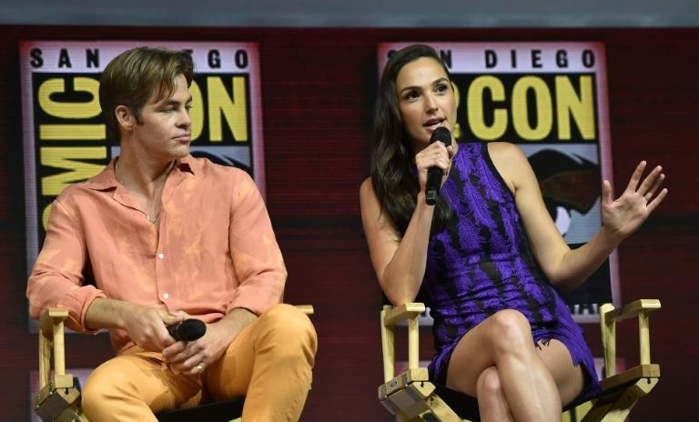 "Chris Pine (L) and Gal Gadot participate in the Warner Bros. Theatrical Panel for ""Wonder Woman 1984,"" which Gadot described as a ""new chapter"" rather than a sequel"