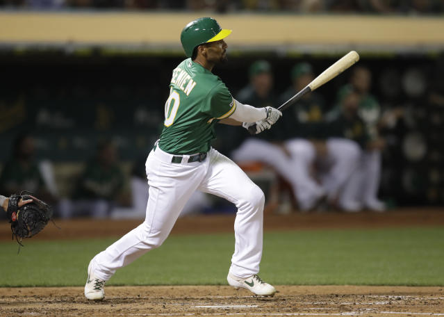Oakland Athletics' Marcus Semien watches his double off Houston Astros' Justin Verlander during the fourth inning of a baseball game Friday, Aug. 16, 2019, in Oakland, Calif. (AP Photo/Ben Margot)