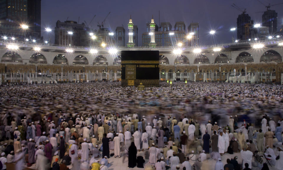 FILE - In this Oct. 3, 2016 file photo, Muslim pilgrims circumambulate the Kaaba, Islam's holiest shrine, the cubic building at the Grand Mosque in the Muslim holy city of Mecca, Saudi Arabia during the minor pilgrimage, known as Umrah that can be undertaken at any time of the year. A very small, limited number of people practiced social distancing as they circled the Kaaba in Mecca on Sunday, Oct. 4, 2020 after Saudi Arabia lifted coronavirus restrictions that had been in place for months allowing the limited restart of Umrah pilgrimages. (AP Photo/Amr Nabil, File)