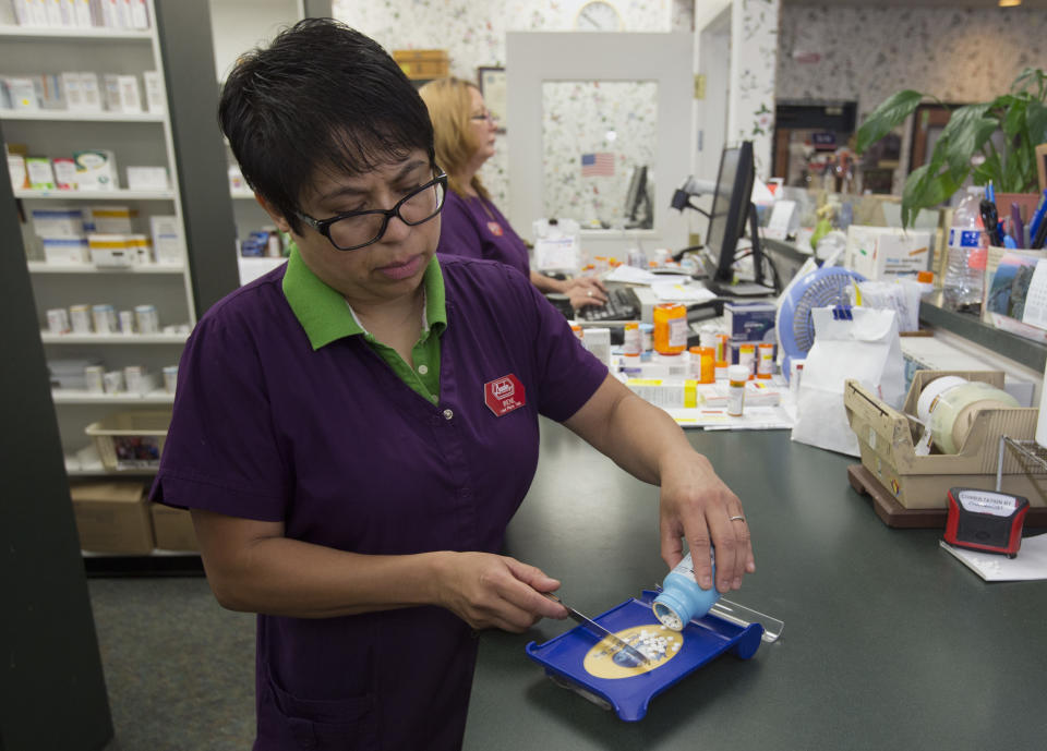 In this Friday, July 8, 2016, photo, pharmacist technician Irene Arrenquin fills a prescription for the anti-diarrhea drug diphenoxylate hydrochloride and atropine sulfate at Pucci's Pharmacy, in Sacramento, Calif. The drug is one of several that has seen a significant cost increase in recent months. In an effort to discourage drugmakers from raising their prices too quickly or introducing new medications that are unaffordable to the average person, state Sen. Ed Hernandez, D-Azusa, has introduced legislation that would require drugmakers to provide advance notice before making big price increases. (AP Photo/Rich Pedroncelli)