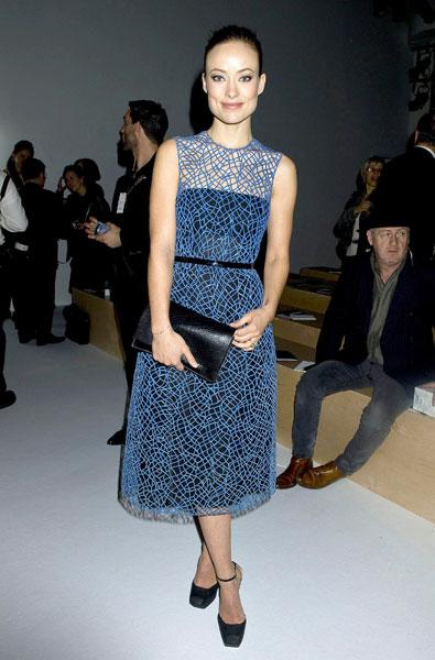 <b>Olivia Wilde </b><br><br>The star donned a blue midi dress for the Calvin Klein show.<br><br>Image © Rex
