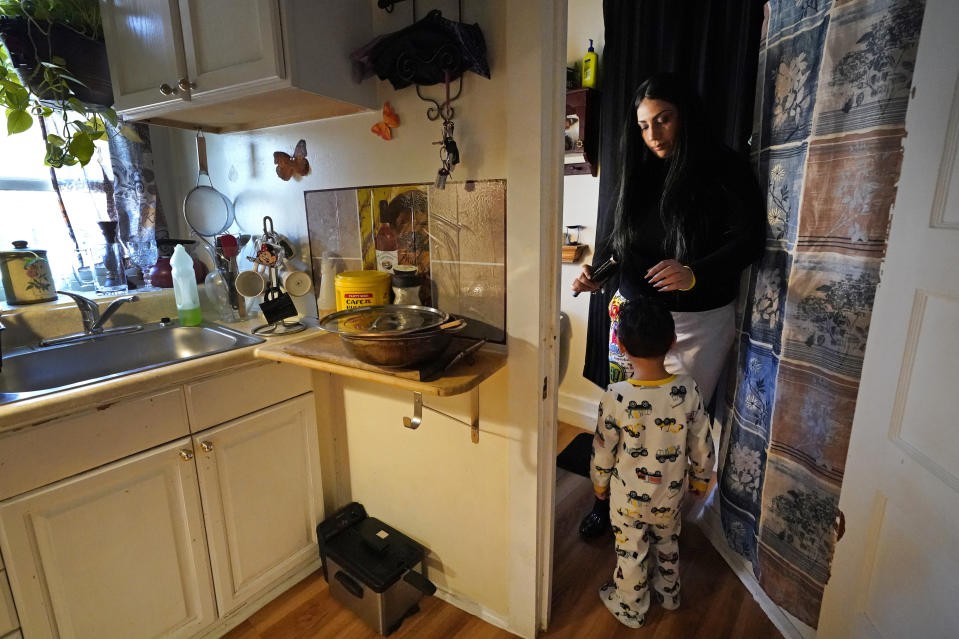 Isabel Miranda brushes the hair of her 4-year-old son, Julian, Wednesday, March 10, 2021, in their rental apartment in Haverhill, Mass. The Biden administration is extending a federal moratorium on evictions of tenants who've fallen behind on rent during the coronavirus pandemic. Miranda, who has an eviction hearing next month from her apartment, said she had mixed feelings about the extension. She worries that the courts and the landlord will not recognize the federal moratorium but also recognizes it gives her time to come up with the nearly $10,000 in back rent. (AP Photo/Elise Amendola)
