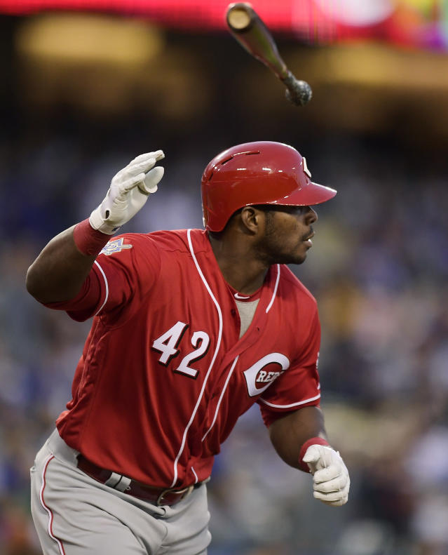 Cincinnati Reds' Yasiel Puig flips his bat after hitting a solo home run during the first inning of a baseball game against the Los Angeles Dodgers, Monday, April 15, 2019, in Los Angeles. (AP Photo/Mark J. Terrill)
