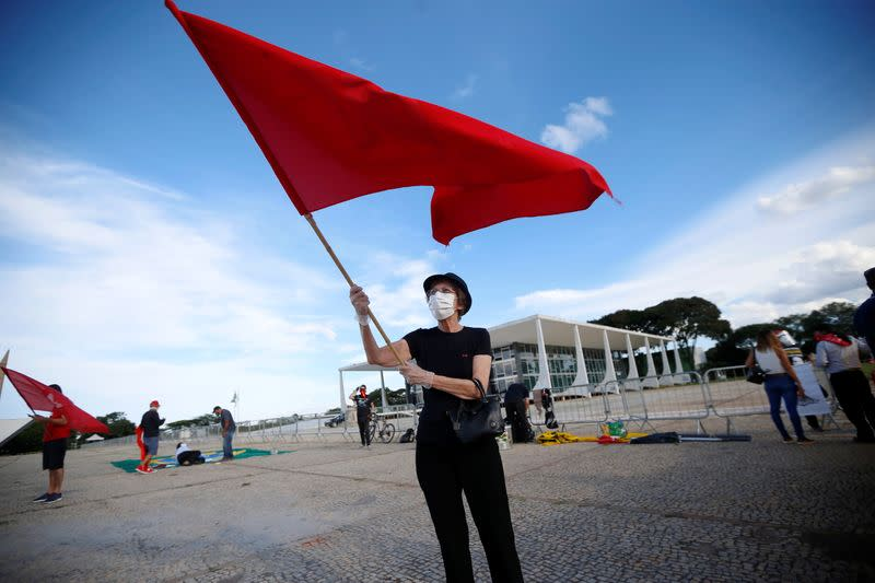 Supporters of Brazil's former President Luiz Inacio Lula da Silva take part in a protest in front of the Supreme Court