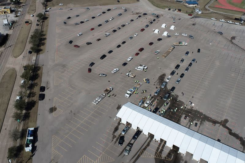 Cars line up to receive free cases of water after the city of Houston implemented a boil water advisory