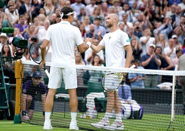 Roger Federer, left, was pushed all the way by Adrian Mannarino