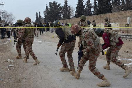 Paramilitary soldiers enter the cordoned site after gunmen shot dead four paramilitary soldiers in Quetta