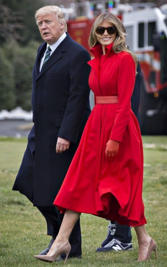 U.S. President Donald Trump and U.S. First Lady Melania Trump walk on the South Lawn of the White House to board Marine One in Washington, D.C - Credit: Bloomberg