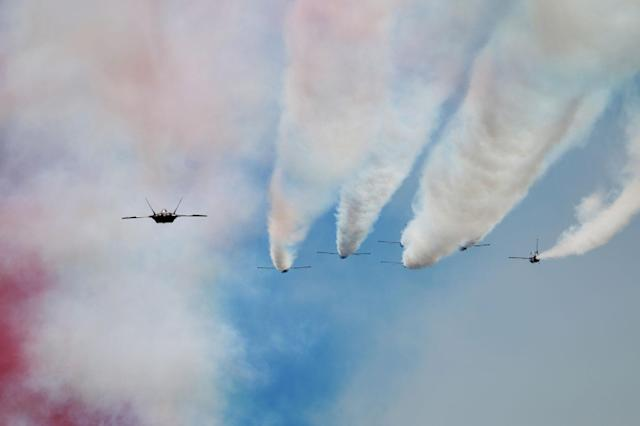 <p>French Alpha jets in a 'Big Nine' formation fly past during the annual Bastille Day parade in French capital Paris on July 14, 2017. (Photo: Zakaria Abdelkafi/AFP/Getty Images) </p>