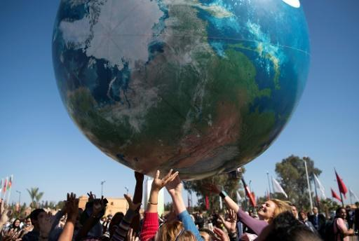 US may stay in Paris climate accord, with caveats