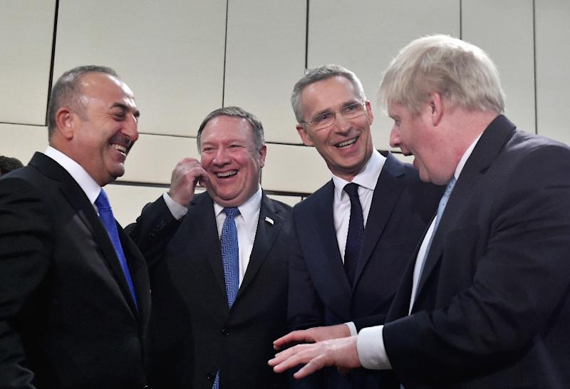 Turkey's Foreign Affairs minister Mevlut Cavusoglu, US Secretary of State Mike Pompeo, NATO Secretary General Jens Stoltenberg and British Foreign Secretary Boris Johnson share a joke before the opening of a Foreign ministers meeting in Brussels (AFP Photo/JOHN THYS)
