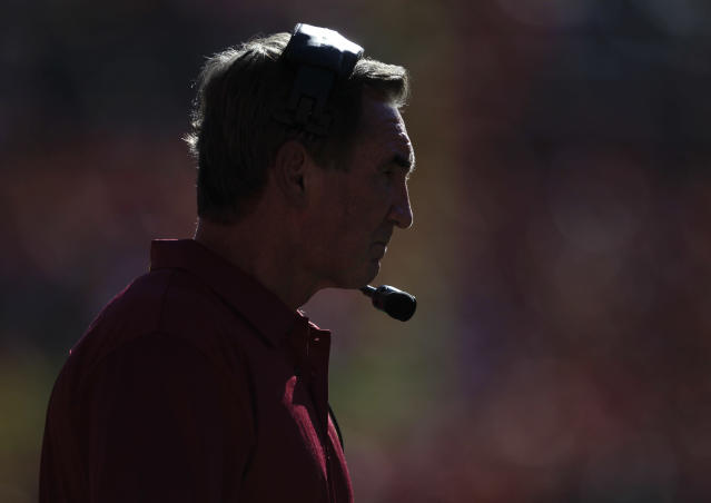 Washington Redskins Mike Shanahan watches play against the Denver Broncos from the sidelines in the second quarter of an NFL football game, Sunday, Oct. 27, 2013, in Denver. (AP Photo/Joe Mahoney)