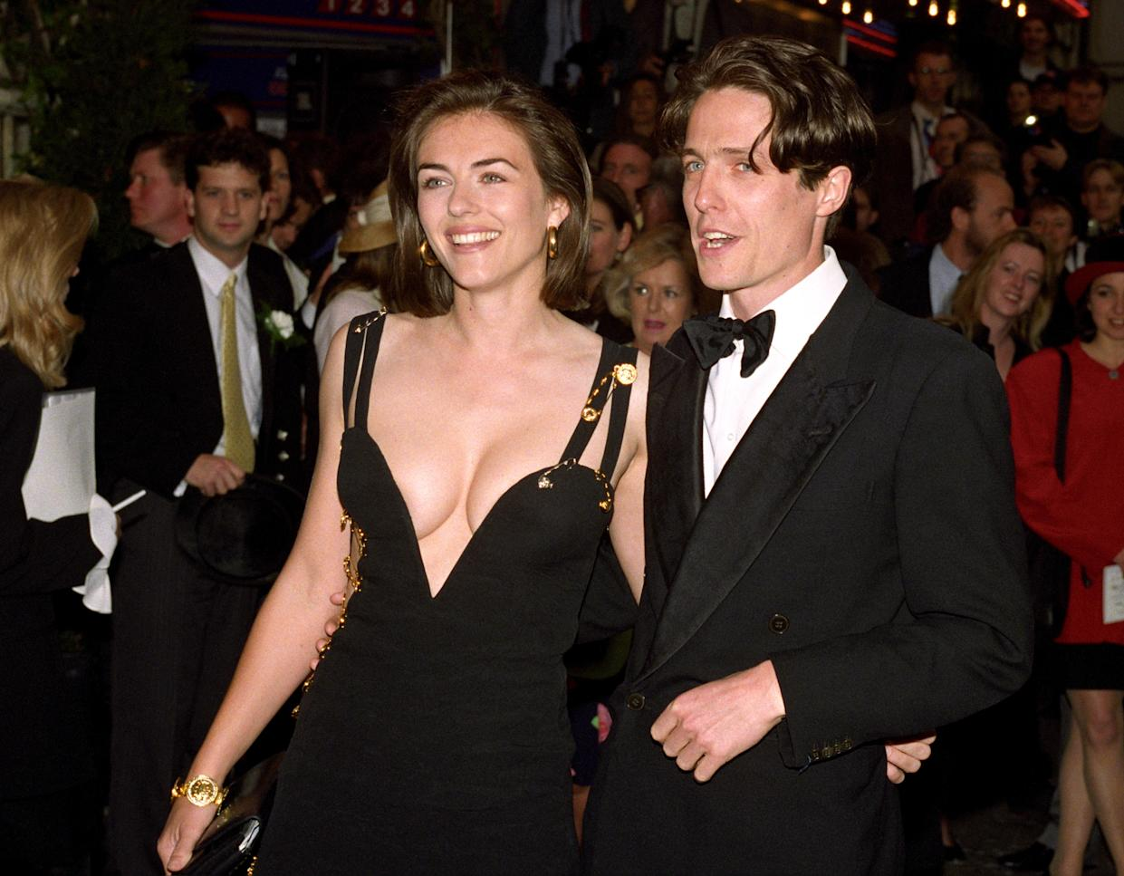 Hugh Grant and Elizabeth Hurley at the premiere of the 1994 film Four Weddings and a Funeral.