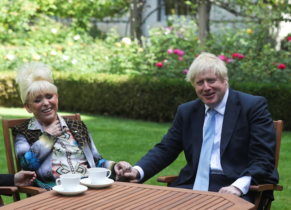 LONDON, ENGLAND - SEPTEMBER 02: Britain's Prime Minister Boris Johnson has a cup of tea with television actress Dame Barbara Windsor during a meeting in London on September 2, 2019 in London, England. Barbara Windsor, who suffers from Alzheimers, met with the Prime Minister at 10 Downing Street to discuss dementia care. (Photo by Simon Dawson - WPA Pool/Getty Images)