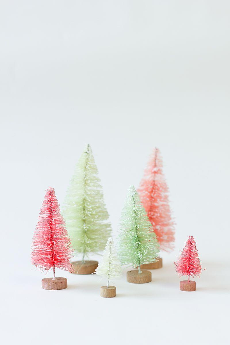 "<p>These would look adorably festive on top of a mantle or breaking up a floral arrangement on your holiday dinner table. Get the tutorial at <a href=""https://studiodiy.com/2013/12/16/diy-gold-dipped-bottle-brush-trees/"" rel=""nofollow noopener"" target=""_blank"" data-ylk=""slk:Studio DIY!"" class=""link rapid-noclick-resp"">Studio DIY!</a>.</p>"