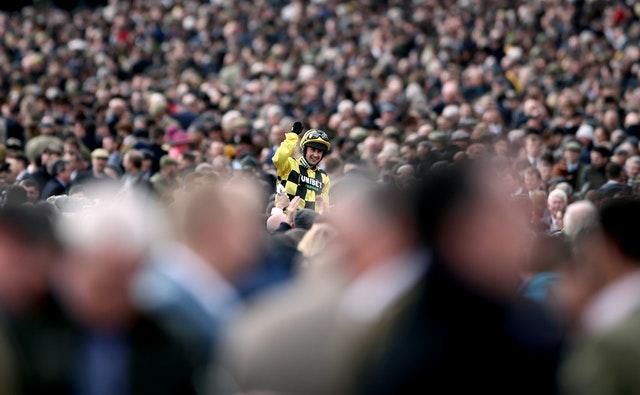 Nico De Boinville celebrates following victory in the the Sky Bet Supreme Novices' Hurdle aboard Shishkin on day one of the Cheltenham Festival in March.The festival, which attracted around 150,000 people, was among the final large sporting events to be held before lockdown measures were introduced.
