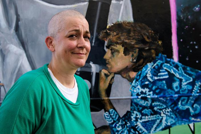 London-based artist Dawn Mellor unveils a mural celebrating the life of George Michael (PA)