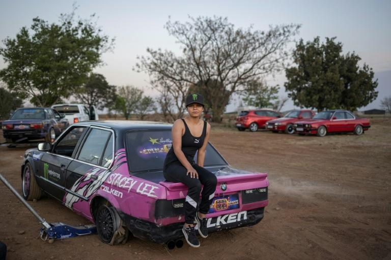 Stacey-Lee May, who has won international fame for her stunts, poses on her car (AFP/Michele Spatari)