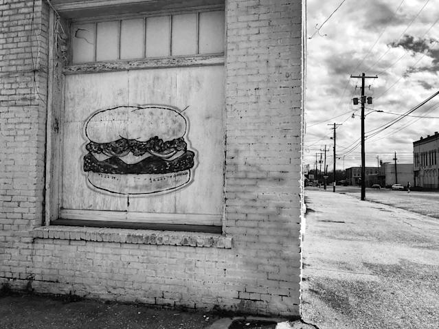 <p>A hamburger is painted on the side of a boarded-up restaurant in downtown Selma, Ala. (Photo: Holly Bailey/Yahoo News) </p>