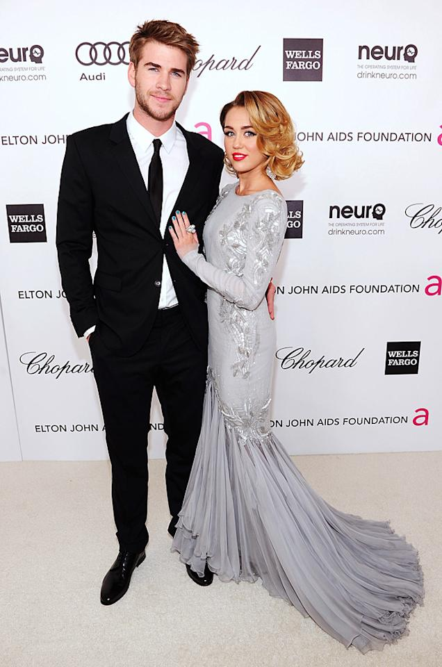 Miley clung to her boy toy, Liam Hemsworth, as they sashayed their way into Elton's event.