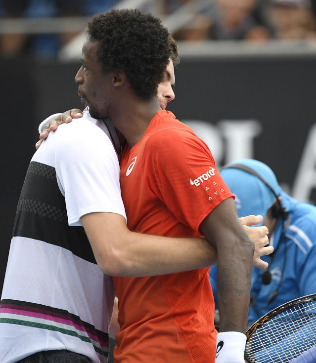 France's Gael Monfils embraces and congratulates United States' Taylor Fritz after their second round match at the Australian Open tennis championships in Melbourne, Australia, Wednesday, Jan. 16, 2019. (AP Photo/Andy Brownbill)